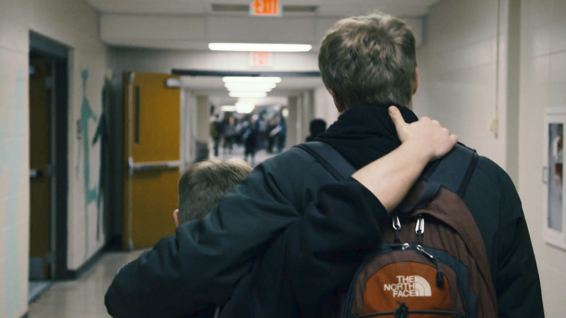 Evan and Jay Hallberg walking down the hallway of Ponaganset High School.