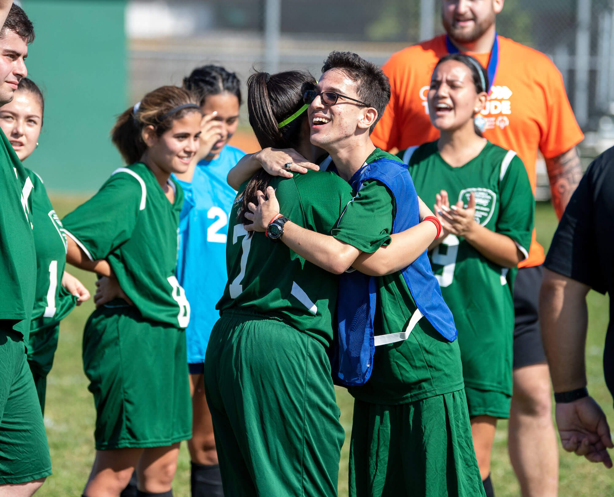 Two students hugging after a Unified soccer game.