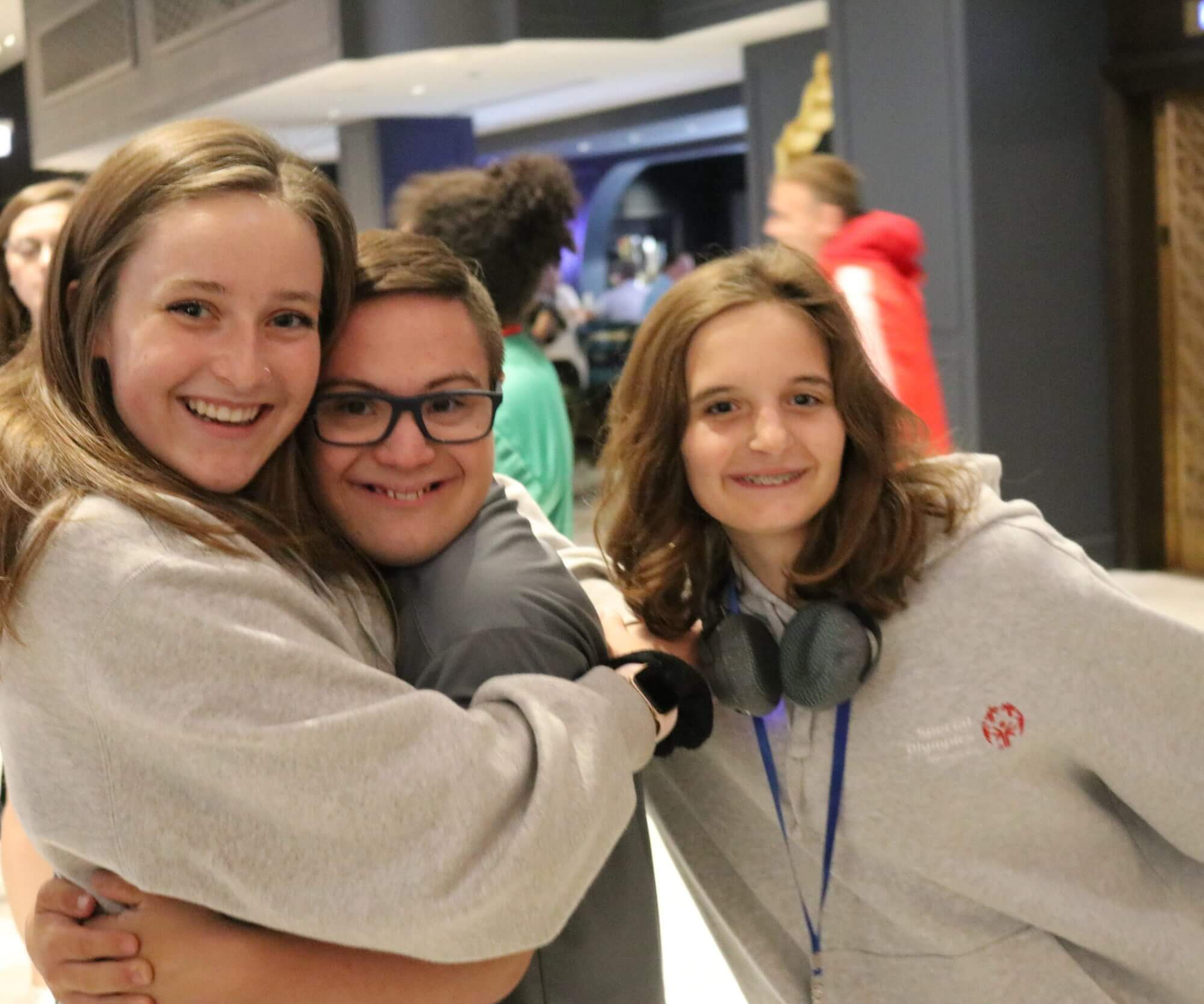 Students embracing at an Inclusive Youth Leadership Summit
