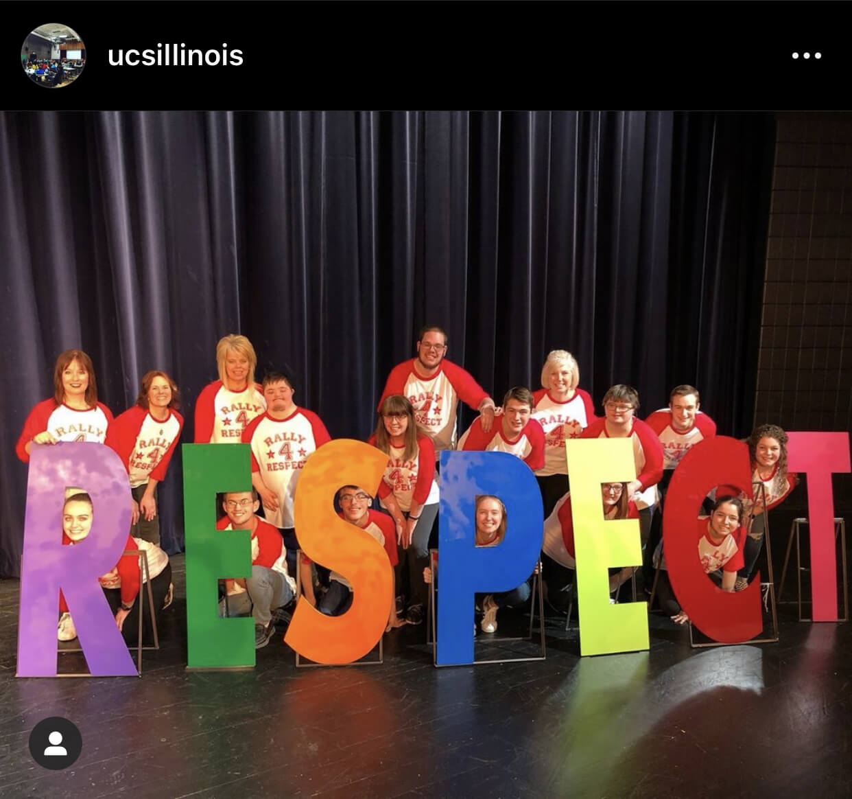 Students with cut out letters that spell respect.