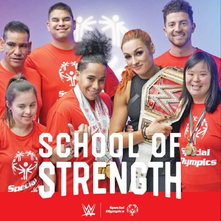 WWE Superstar Becky Lynch posing with Special Olympics athletes to promote School of Strength.