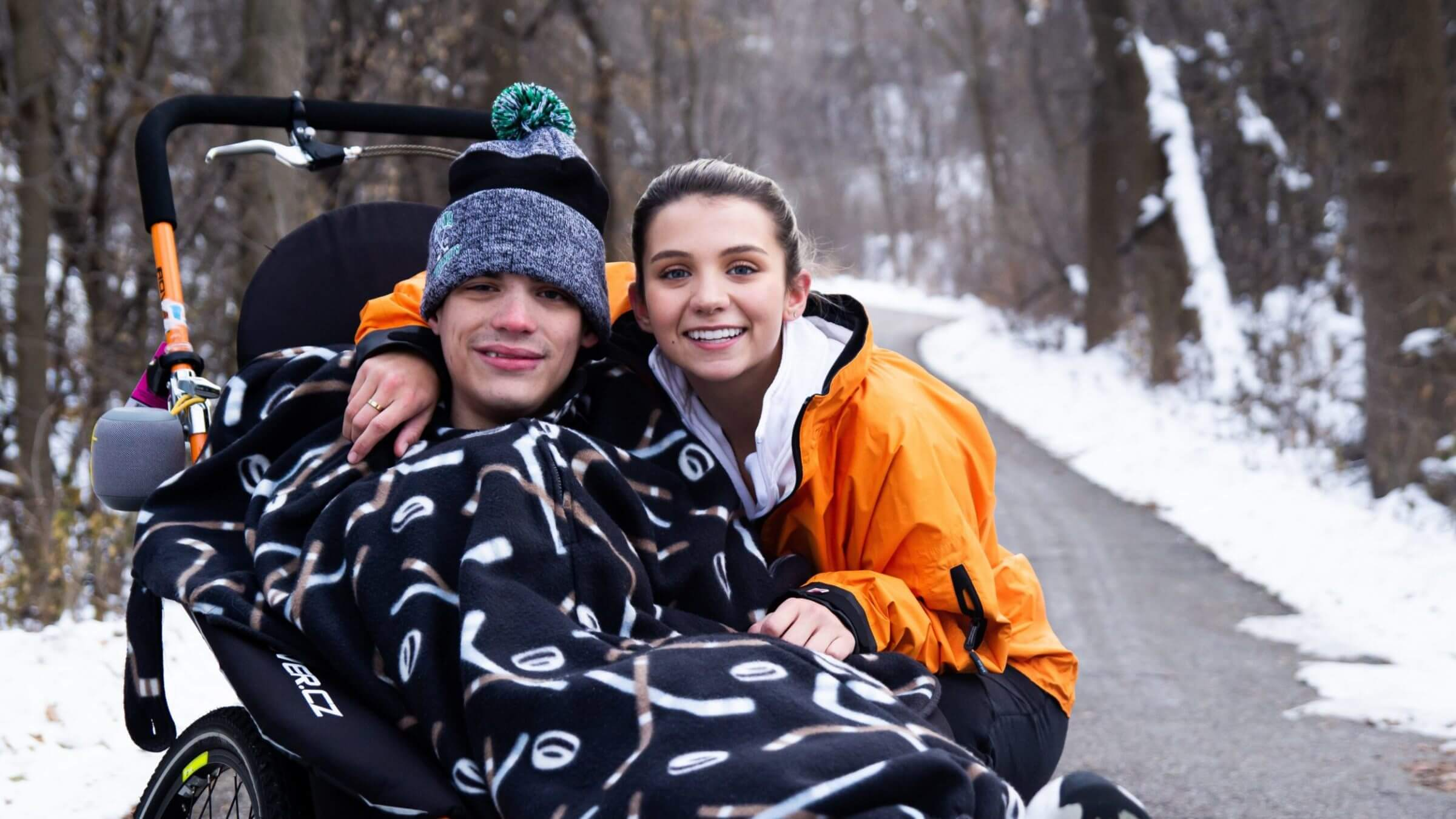 Patrick, who is in a wheelchair, and his sister Megan posing while on a run.