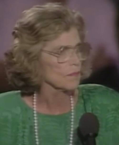 Special Olympics founder Eunice Kennedy Shriver delivers a speech at a podium.