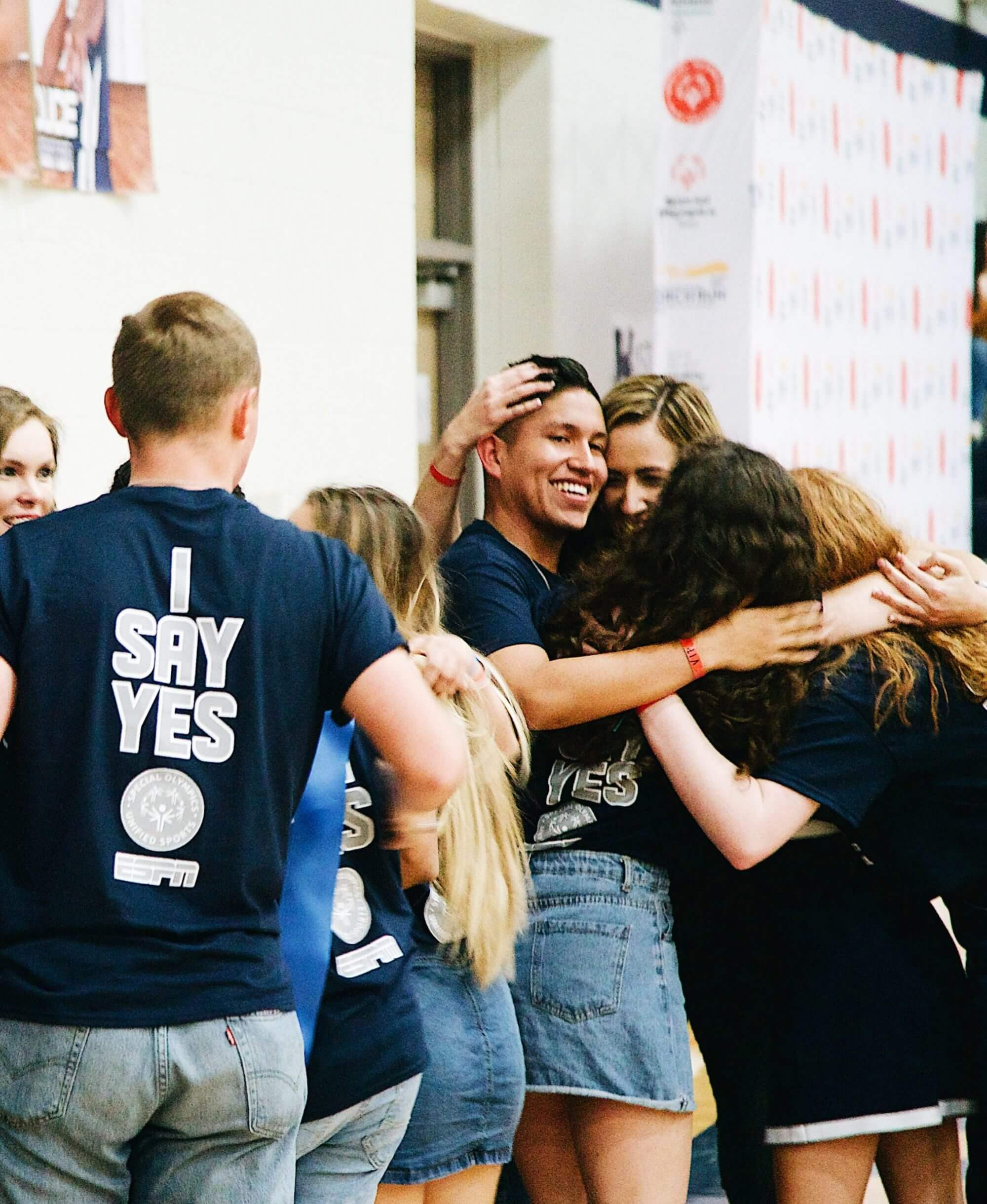 A group of Hendrickson High School students hugging.